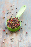 Colorful Pepppercorns. Colorful peppercorns on a wooden base royalty free stock image