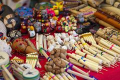 Colorful Peruvian artisanal crafts and Andean musical instruments royalty free stock photo
