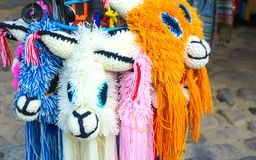 Colorful Peruvian llama head hats in the market in Machu Picchu, one of the New Seven Wonder of The World, Cusco Region Peru, stock image