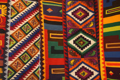 Colorful Peruvian textiles. Wool  Peruvian textiles. Traditional fabric designs Royalty Free Stock Images
