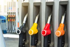 Colorful petrol pistols pump filling nozzles, refueling gas stations in a service. Stock Images