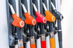Colorful petrol pistols pump filling nozzles, refueling gas stations in a service. Royalty Free Stock Images