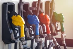 Colorful Petrol pump filling nozzles, Gas station in a service stock photos