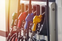 Colorful Petrol pump filling nozzles, Gas station in a service royalty free stock photo