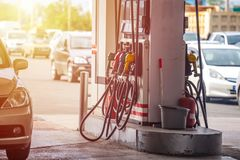 Colorful Petrol pump filling nozzles, Gas station in a service royalty free stock image