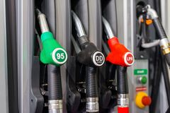 Colorful Petrol pump filling nozzles , Gas station in a service. In daytime Royalty Free Stock Images