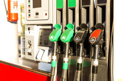 Colorful Petrol pump filling nozzles. Gas station in a service in daytime.  Royalty Free Stock Photo
