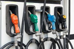 Colorful Petrol pump filling nozzles, Gas station in a service stock photography