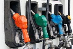 Colorful Petrol pump filling nozzles, Gas station in a service stock photo