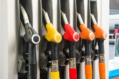 Colorful Petrol pump filling nozzles, refueling gas stations in a service. Royalty Free Stock Image
