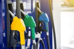 Colorful Petrol pump filling nozzles on white background. Gas station in a service in warm sunset.Head fuel vehicle refueling facility in asia stock photos