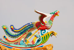 Colorful pheasant statue on roof Stock Photo