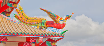 Colorful Phoenix on temple roof. In a temple in Thailand royalty free stock photos