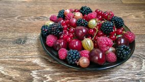 Colorful photo of berries on the plate royalty free stock photography