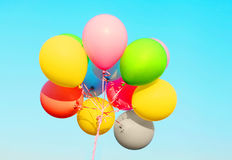 Colorful photo bundle air balloons on sky blue background Royalty Free Stock Image