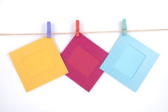 Colorful photo frames on white background clothespins . Stock Photography