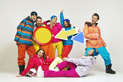 Colorful photo of the glad snowboarders Royalty Free Stock Image