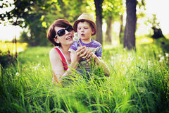 Colorful photo of mother and kid playing blow-balls Stock Images