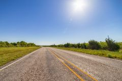Empty highway road with sun Royalty Free Stock Photo