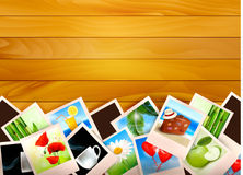 Colorful photos on wooden background. Stock Images