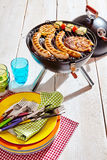 Colorful picnic plates and utensils at a barbecue Stock Photography