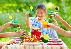 Colorful picnic table with group of kids around Royalty Free Stock Photos