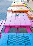 Colorful Picnic Tables with Checkerboards Stock Photo