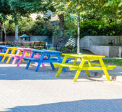 Colorful Picnic Tables on Cobblestone Street Stock Photography