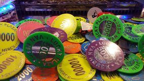 Colorful picture of a coin slot jackpot machine. Showing the colorful coins and the slider stock photo