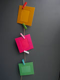 Colorful picture frame hanging on the ropes Royalty Free Stock Image