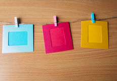 Colorful picture frame hanging on the ropes Royalty Free Stock Photos