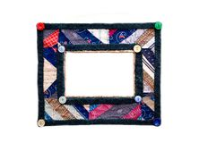Colorful picture frame/quilt. A picture frame I made from an old quilt and decorated with buttons stock image