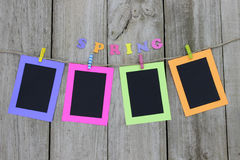 Colorful picture frames hanging on clothesline Royalty Free Stock Photography