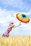 Colorful picture of holding rainbow umbrella Royalty Free Stock Photography