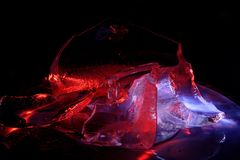 Colorful ice pieces painted by light royalty free stock image