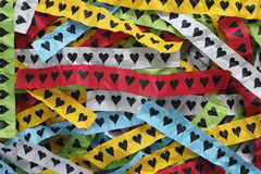 Colorful pieces of paper with hearts Royalty Free Stock Photo