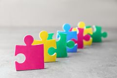 Colorful pieces of puzzle. On light background Royalty Free Stock Photos