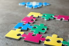 Colorful pieces of puzzle. On grey background Royalty Free Stock Image