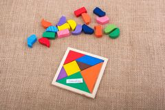 Pieces of a square tangram puzzle Stock Image