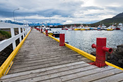 Colorful pier at Dalvik harbor in north Iceland Stock Photos