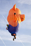 Colorful pig balloon taking off Stock Images