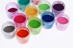 Colorful pigments powders. Isolated on white royalty free stock image