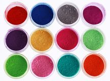 Colorful pigments powders. Isolated on white royalty free stock photo