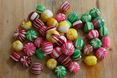 Colorful pile of candies on a wooden surface Stock Photography