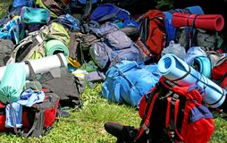 Colorful pile of knapsacks of Scouts during an excursion in the Royalty Free Stock Images