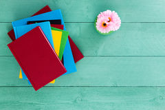 Free Colorful Pile Of Books Stacked On A Green Table Royalty Free Stock Photography - 71316177