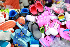 Colorful pile shoes in the market. Stock Photos