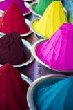 Colorful Piles of Indian Bindi Powder at Local Market. Colorful piles of Indian bindi powder dye at outdoor local Devaraja Market in Mysore India blue, yellow Royalty Free Stock Photo