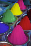 Colorful Piles of Indian Bindi Powder at Local Market. Colorful piles of Indian bindi powder dye at outdoor local Devaraja Market in Mysore India blue, yellow Royalty Free Stock Photos