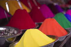 Colorful Piles of Indian Bindi Powder at Outdoor Market. Colorful piles of Indian bindi powder dye at outdoor market in Mysore, India yellow, orange, green, red Royalty Free Stock Image